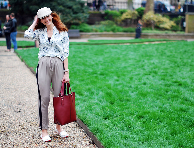 Floral print top, black stripe taupe pants