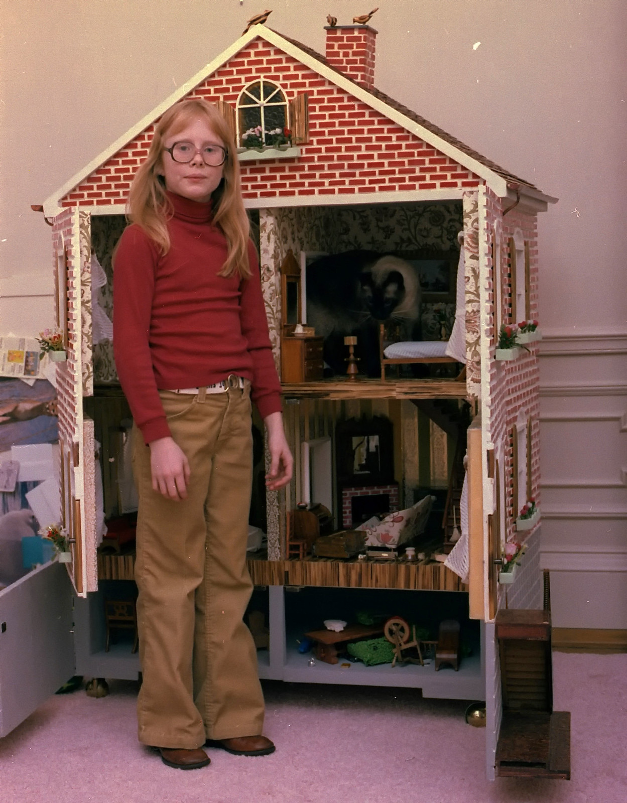 President Carter's daughter Amy poses with her dollhouse at the White House, 1978