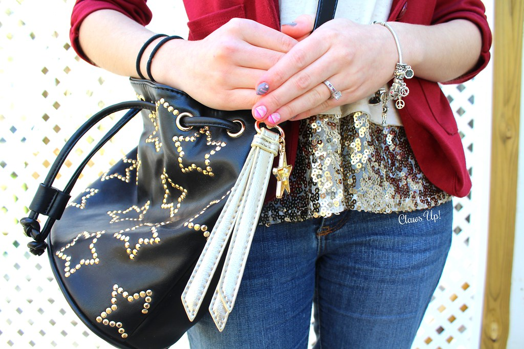 Betsey Johnson star bucket bag, red blazer, and gold sequin top.