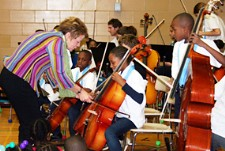 Baltimore Symphony Music Director Marin Alsop coaches students in the BSO OrchKids program