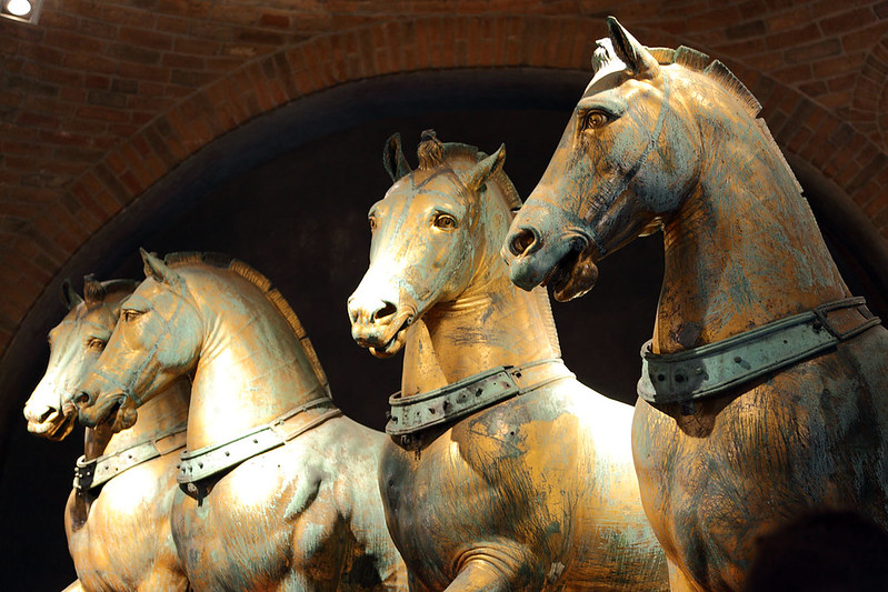 Four bronze horses