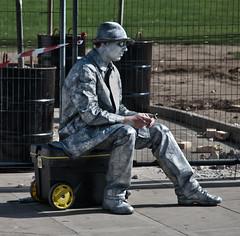 sculpture(0.0), road(0.0), monument(0.0), street artist(0.0), statue(0.0), art(1.0), street(1.0), infrastructure(1.0), sitting(1.0),