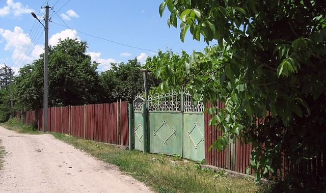 Green gate and red fence in Ivancea