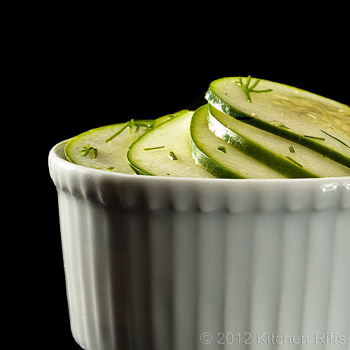 Hungarian Cucumber Salad in White Ramekin, Black Background