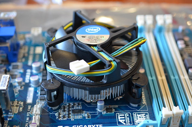 After applying the Thermal Paste, the Intel stock cooler is fitted.