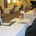 IWU Alum Cully Summers of The Condon Group interviewing a student --
