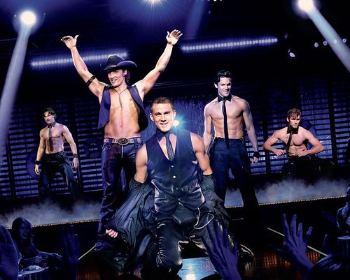 promo poster from Magic Mike showing the leads of the movie on stage in their stripper clothes