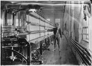 Mule-spinning room in Chace Cotton Mill. Raoul Julien a back-roping boy. Has been here 2 years. Burlington, Vt, May 1909