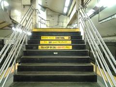 sport venue(0.0), beam(0.0), escalator(0.0), handrail(1.0), stairs(1.0),