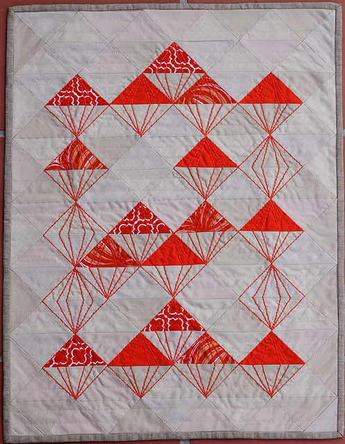 Quilted table runner made from half square triangles