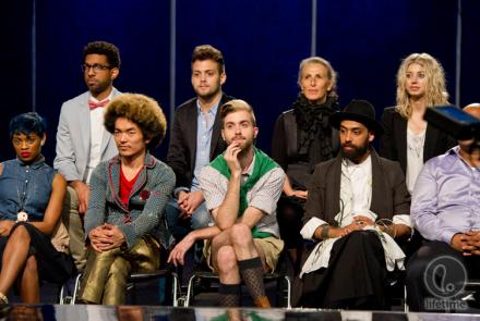 the designers sitting on the runway during the fashion show
