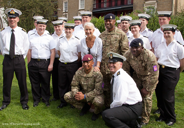 Dame Helen Mirren poses for photographs with military troops in Wapping Rose Gardens