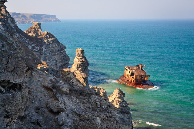 Wrecked ship under rocks