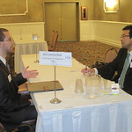 Recruiter Rick Cheng of MB Financial Bank interviewing IWU student Bill Erlaine --