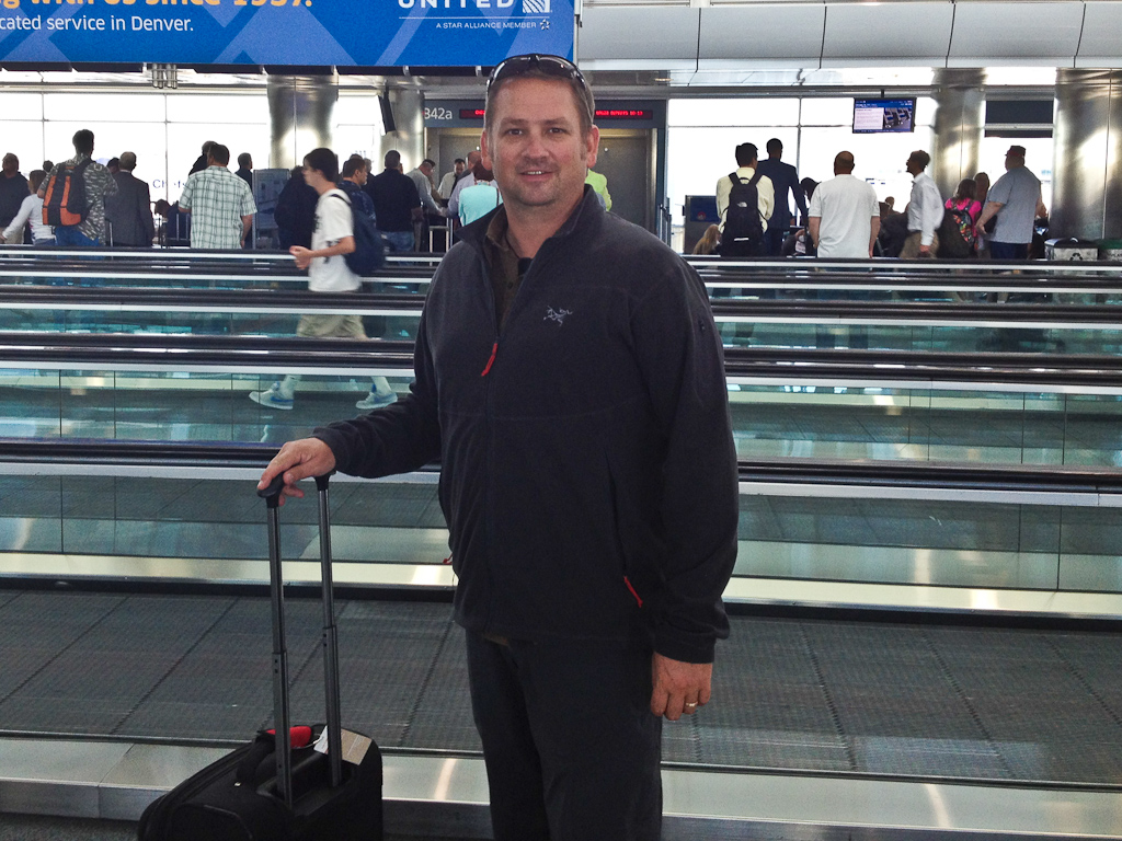 travel blogger Dave of ThePlanetD at airport in Arc'teryx
