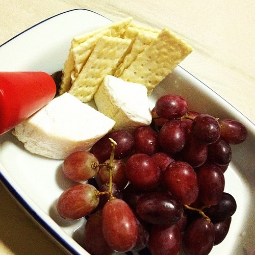 TV time! While munching on grapes, crackers and soft cheeses, paired with a glass of red wine.