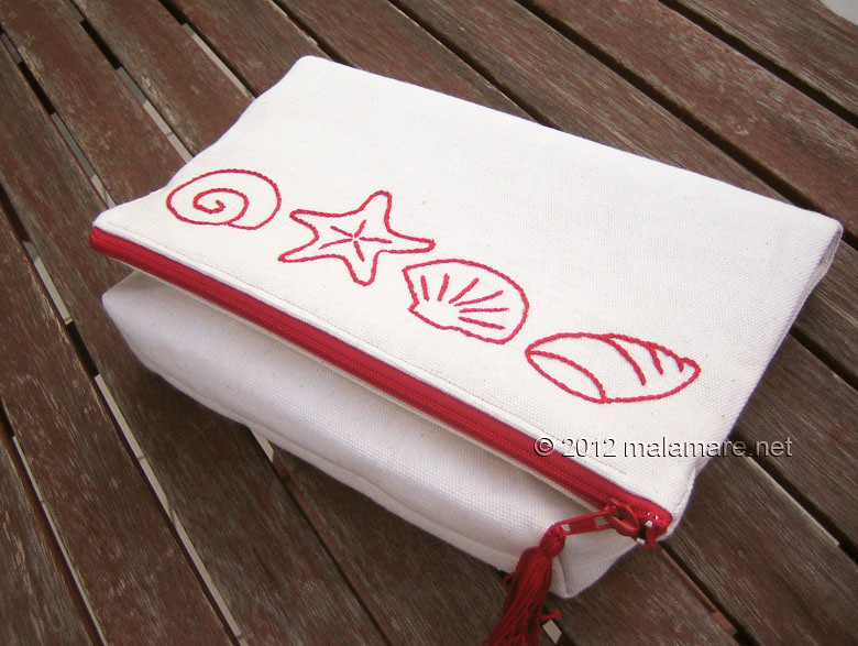 foldover cotton clutch with red hand embroidery