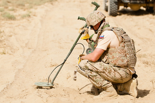 A Slovakian Army explosive ordinance disposal specialist performs a fine cleaning