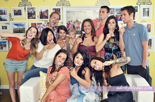 gender reveal party: they think it's a girl so they held up lip cake pops