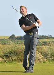 individual sports(1.0), professional golfer(1.0), sports(1.0), recreation(1.0), outdoor recreation(1.0), golf club(1.0), fourball(1.0), golf(1.0), golf equipment(1.0), golfer(1.0),