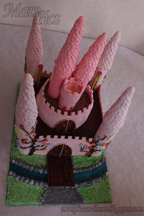Pink girl castle cake