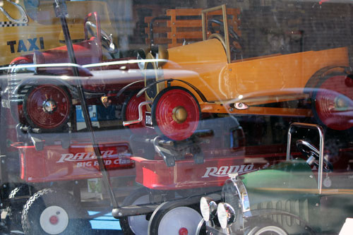 toy cars in a window: cape cod