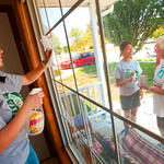 12-033 -- During Mission Day, Sarah Belcher '16 washed windows while Megan Win '16 got some advice on painting from Marilea White '63.