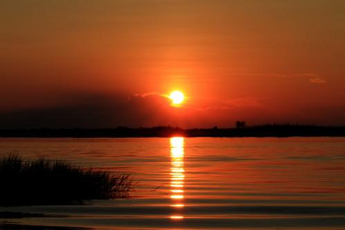 africa light sunset sun water canon reflections river dark eos golden twilight botswana southernafrica choberiver eos7d efs1585isusm