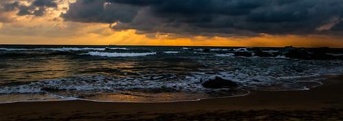 ocean travel sunset sky beach water clouds boat rocks asia waves sunburst srilanka