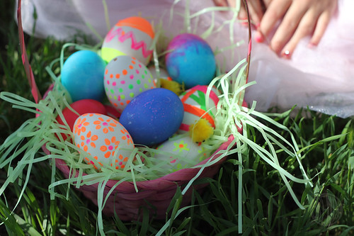 basket filled with painted and decorated Easter eggs