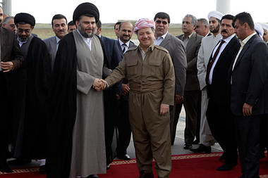 Shiite cleric Muqtada al-Sadr, center left, shakes hands with Kurdish president Massoud Barzani, center right, upon his arrival in Erbil, north of Baghdad, Iraq, April 26. by Pan-African News Wire File Photos