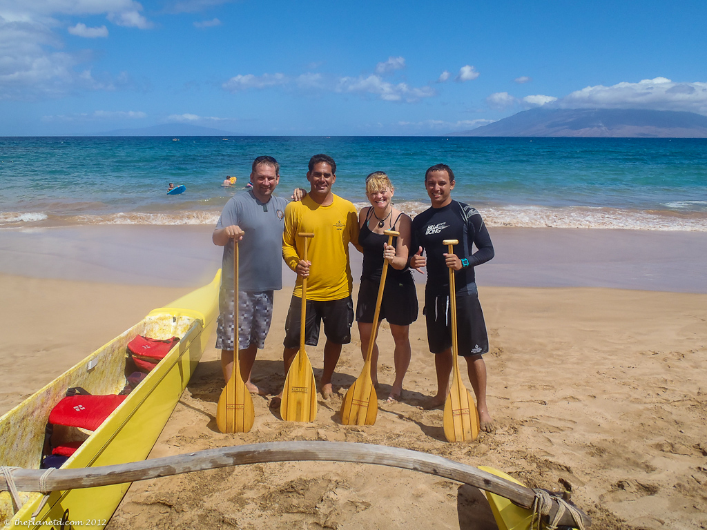 Adventure couple with guides of outrigger canoe