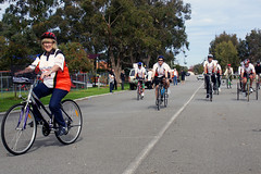 Minister Helen Morton rides with the team & other community members to Steel Blue Oval