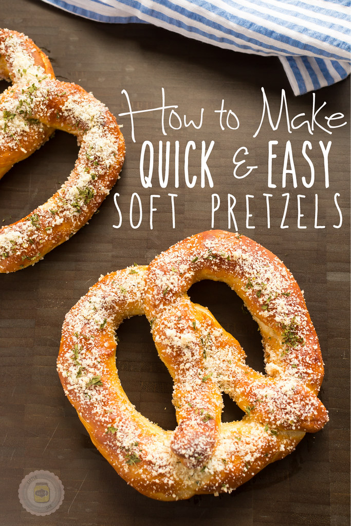 garlic parmesan soft pretzels with text on brown surface