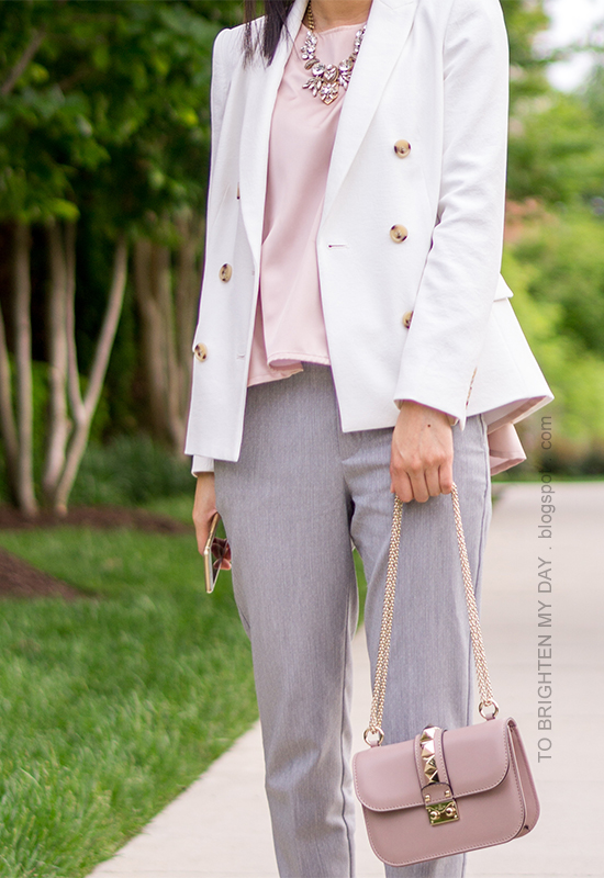 white blazer, pink peplum top, gray pants, nude crossbody bag