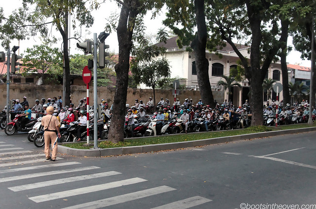 Scooters in Saigon awaiting a light