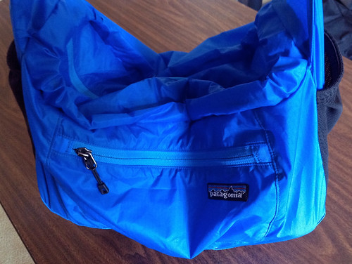 Patagonia Lightweight Travel Courier with camera supported by strap