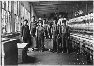 Some of the doffers and the Supt. Ten small boys and girls about this size out of a force of 40 employees. Catawba Cotton Mill, December 1908
