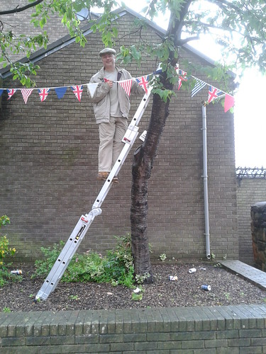 Jonathan putting up bunting Jul 12 2