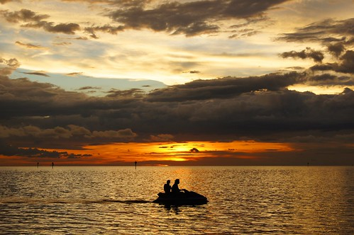 sunset woman man gulfofmexico water clouds florida jetski