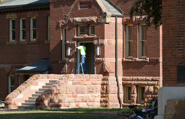 Workers install new doors around Alumni Hall. Photo by John Williams