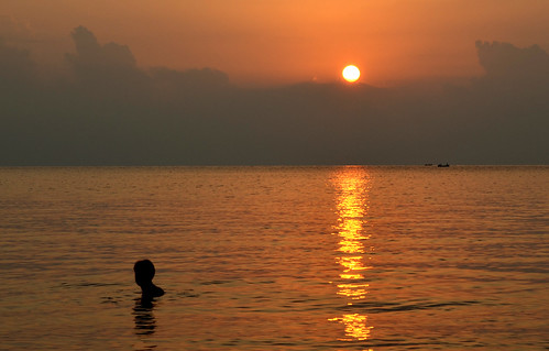 Eric swimming at Olympos beach during sunrise.