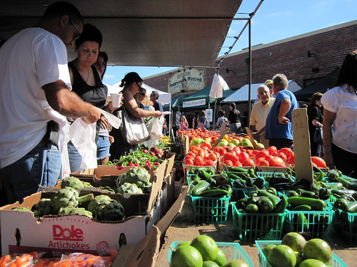 Customers scoop up a handful of the healthy, fresh produce available at one of the many farmers' markets found in communities across America.