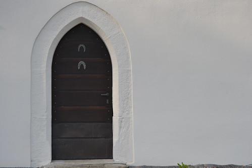 Chapel door with horseshoes