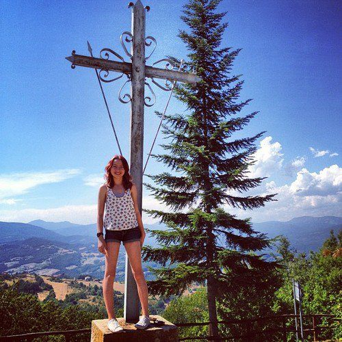 Me on the cross, which stands just outside the cemetery gates.