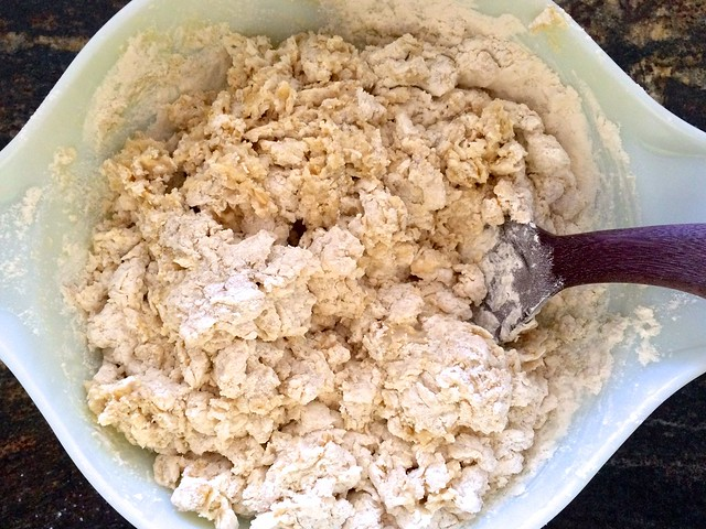 Mixing Dough Together with Wood Spoon