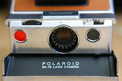 compact cassette(0.0), digital camera(0.0), eye(0.0), cameras & optics(1.0), camera(1.0), instant camera(1.0),