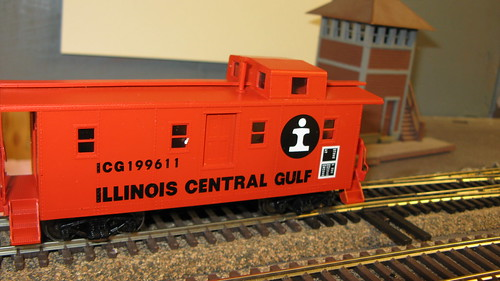 Orange 1970's era Illinois Central Gulf Railroad side door caboose. by Eddie from Chicago