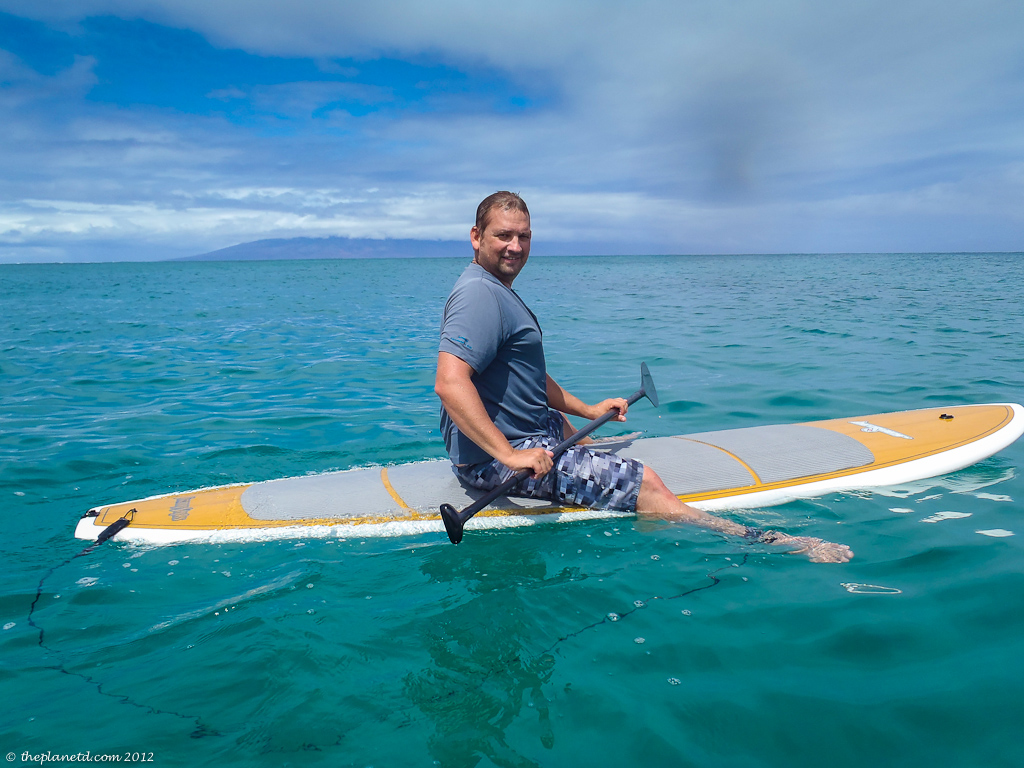 vacation photo of dave sitting on a surf board