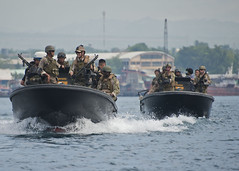 In this file photo, members of U.S. Navy Riverine Squadron 3 work with members of Philippine Navy Seal Team 7 during a patrolling and formation training event July 5 in Sarangani Bay, Philippines, as part of exercise Cooperation Afloat Readiness and Training. (U.S. Navy photo by Mass Communication Specialist 3rd Class Gregory A. Harden II)